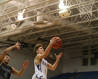 Poland's Mike Diaz (2) goes up for a layup as Harding's Chris Hughes (4) tries to block his shot from behind in the first quarter of an AAC high school basketball game, Tuesday, Dec. 5, 2017, in Poland. Poland won 57-40...(Nikos Frazier | The Vindicator)..