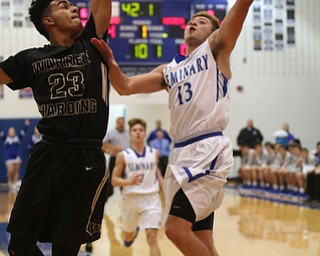Poland's Brandon Barringer (13) goes up for a layup against Harding's Dom McGhee (23) in the first quarter of an AAC high school basketball game, Tuesday, Dec. 5, 2017, in Poland. Poland won 57-40...(Nikos Frazier | The Vindicator)..