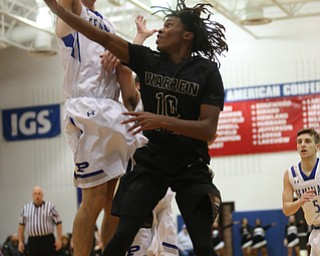 Harding's D'Muntize Owens (10) goes up for a layup under Poland's Daniel Kramer (10) in the second quarter of an AAC high school basketball game, Tuesday, Dec. 5, 2017, in Poland. Poland won 57-40...(Nikos Frazier | The Vindicator)..