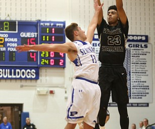 Harding's Dom McGhee (23) goes up for three as Poland's Brandon Barringer (13) attempts to block his shot in the second quarter of an AAC high school basketball game, Tuesday, Dec. 5, 2017, in Poland. Poland won 57-40...(Nikos Frazier | The Vindicator)..