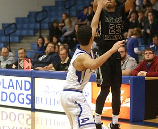 Harding's Dom McGhee (23) goes up for three as Poland's Braeden O'Shaugnessy (3) attempts to block his shot in the second quarter of an AAC high school basketball game, Tuesday, Dec. 5, 2017, in Poland. Poland won 57-40...(Nikos Frazier | The Vindicator)..