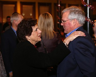 Mahoning County Commissioner Carol Rimedio-Righetti greets Boardman Police Chief Jack Nichols during a retirement party honoring Chief Nichols, Wednesday, Dec. 6, 2017, at Magic Tree Pub & Eatery in Boardman. Chief Nichols will officially retire on December 31, after having served 40 years with the Boardman Police Department...(Nikos Frazier | The Vindicator)