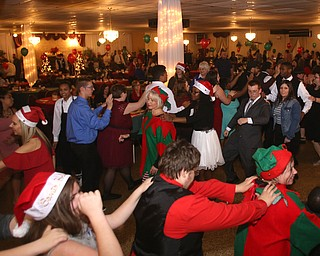 A conga line breaks out during the 13th annual Winterfest special needs dance, Wednesday, Dec. 6, 2017, at the Mahoning Country Club in Girard...(Nikos Frazier | The Vindicator)