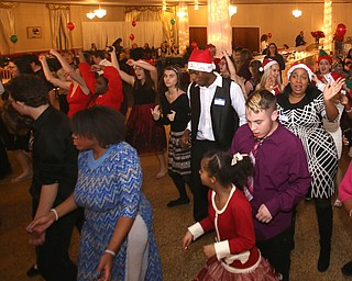 """Students dance to the """"Cupid Shuffle"""" during the 13th annual Winterfest special needs dance, Wednesday, Dec. 6, 2017, at the Mahoning Country Club in Girard...(Nikos Frazier 