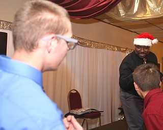 Youngstown Mayor-elect Jamael Tito Brown dances with some students while DJ'ing the 13th annual Winterfest special needs dance, Wednesday, Dec. 6, 2017, at the Mahoning Country Club in Girard...(Nikos Frazier | The Vindicator)