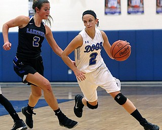 POLAND, OHIO - DECEMBER 6, 2017: Poland's Sarah Bury (2) drives past Lakeview's Lindsay Carnahan (2) during the.1st qtr. at Poland High School.  MICHAEL G. TAYLOR | THE VINDICATOR