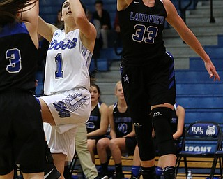 POLAND, OHIO - DECEMBER 6, 2017: Poland's Brooke Bobbey (1) has her shot blocked by Lakeview's Annie Pavlansky (33)  during the 2nd qtr. at Poland High School.  MICHAEL G. TAYLOR | THE VINDICATOR