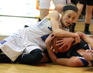 POLAND, OHIO - DECEMBER 6, 2017:  Poland's Bella Gajdosl (0) and Lakeview's Lindsay Carnahan (2) battle for the ball during the 2nd qtr. at Poland High School.  MICHAEL G. TAYLOR | THE VINDICATOR