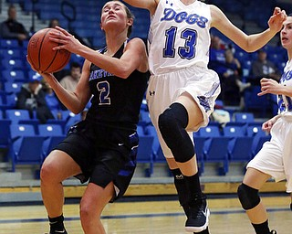 POLAND, OHIO - DECEMBER 6, 2017: Poland's Maggie Sebest (13) defends against Lakeview's Lindsay Carnahan (2) during the 3rd qtr. at Poland High School.  MICHAEL G. TAYLOR | THE VINDICATOR
