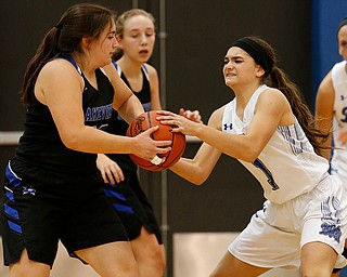 POLAND, OHIO - DECEMBER 6, 2017: Poland's Brooke Bobbey (1) steals the ball from Lakeview's Laura Garvin (32) during the 3rd qtr. at Poland High School.  MICHAEL G. TAYLOR | THE VINDICATOR