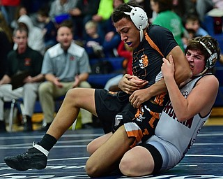 AUSTINTOWN, OHIO - DECEMBER 21, 2017: Howland's Brandon Summerlin is drug down to the mat by Boardman's John Fleet during their 160lb bout, Thursday night at Austintown Fitch High School. DAVID DERMER | THE VINDICATOR
