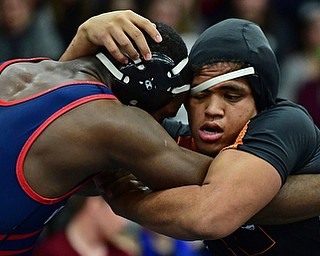 AUSTINTOWN, OHIO - DECEMBER 21, 2017: Howland's Brandon Matlock, right, grapples with Fitch's Breylon Douglas during their 220lb bout, Thursday night at Austintown Fitch High School. DAVID DERMER | THE VINDICATOR