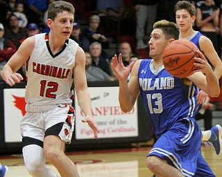 William D. Lewis The Vindictor  Poland's Brandon Barringer(13) drives to the hoop past Canfield's Ethan Kalina(12) during a sold out game at Canfield 12-22-17.