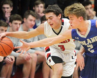 William D. Lewis The Vindictor  Canfield's Ben Shapiro(3)and Poland's Mike Diaz(2)  go for the ball during a sold out game at Canfield 12-22-17.