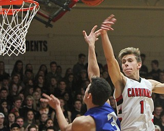 William D. Lewis The Vindictor  Poland's Braeden O'Shaungnessy(3) drives to the hoop past Canfield'sAydin Hanousek(1) during a sold out game at Canfield 12-22-17.