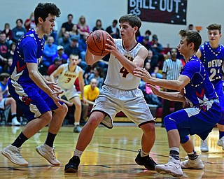 CANFIELD, OHIO - DECEMBER 22, 2017: South Range's Brennan Toy, center, is pressured by Western Reserve's Nic Corbett, left, and Riley Miller, right, during the first half of their game on Friday night at South Range High School. DAVID DERMER | THE VINDICATOR