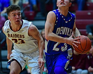 CANFIELD, OHIO - DECEMBER 22, 2017: Western Reserve's Cole DaZee goes to the basket against South Range's Jaxon Anderson during the first half of their game on Friday night at South Range High School. DAVID DERMER | THE VINDICATOR