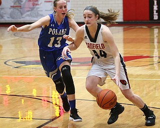 Canfield guard Grace Mangapora (44) drives towards the net against Poland forward Maggie Sebest (13) in the first quarter of an AAC high school basketball game, Friday, Dec. 23, 2017, in Canfield. Canfield won 45-34...(Nikos Frazier | The Vindicator)