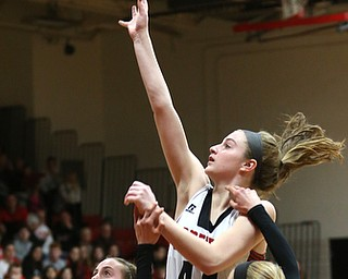 Canfield guard Grace Mangapora (44) goes up for a layup in the first quarter of an AAC high school basketball game, Friday, Dec. 23, 2017, in Canfield. Canfield won 45-34...(Nikos Frazier | The Vindicator)