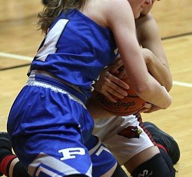 Canfield guard Ashley Veneroso (23) and Poland guard Gabby Romano (34) fight for the ball in the first quarter of an AAC high school basketball game, Friday, Dec. 23, 2017, in Canfield. Canfield won 45-34...(Nikos Frazier | The Vindicator)