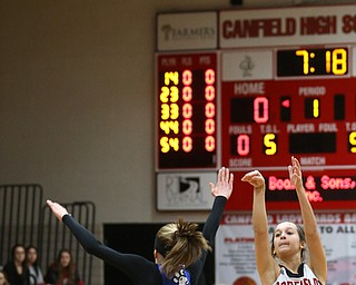 Canfield guard Ashley Veneroso (23) goes up for three  as Poland guard Bella Gajdos (0) attempts to block her shot in the first quarter of an AAC high school basketball game, Friday, Dec. 23, 2017, in Canfield. Canfield won 45-34...(Nikos Frazier | The Vindicator)