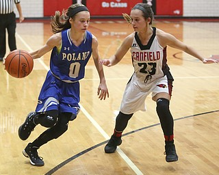 Poland guard Bella Gajdos (0) drives towards the net against Canfield guard Ashley Veneroso (23) in the third quarter of an AAC high school basketball game, Friday, Dec. 23, 2017, in Canfield. Canfield won 45-34...(Nikos Frazier | The Vindicator)