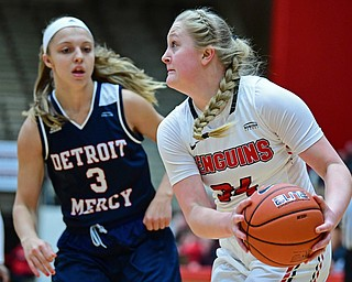 YOUNGSTOWN, OHIO - DECEMBER 28, 2017: Youngstown State's McKenah Peters drives on Detroit's Lora Ristovski during the first half of their game on Thursday night at Beeghly Center. Youngstown State won 76-59. DAVID DERMER | THE VINDICATOR