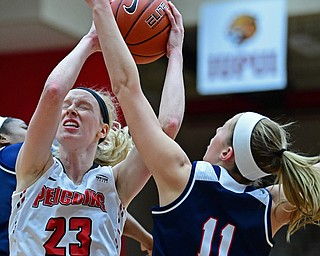 YOUNGSTOWN, OHIO - DECEMBER 28, 2017: Youngstown State's Sarag Cash attempts to put up a shot while being guarded by Detroit's Lexey Tobel during the first half of their game on Thursday night at Beeghly Center. Youngstown State won 76-59. DAVID DERMER | THE VINDICATOR