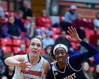 YOUNGSTOWN, OHIO - DECEMBER 28, 2017: Youngstown State's Anne Secrest and Detroit's Brianne Cohen battle for a rebound during the first half of their game on Thursday night at Beeghly Center. Youngstown State won 76-59. DAVID DERMER | THE VINDICATOR