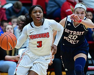YOUNGSTOWN, OHIO - DECEMBER 28, 2017: Youngstown State's Indiya Benjamin drives on Detroit's Nicole Urbanick during the second half of their game on Thursday night at Beeghly Center. Youngstown State won 76-59. DAVID DERMER | THE VINDICATOR