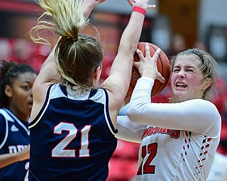 YOUNGSTOWN, OHIO - DECEMBER 28, 2017: Youngstown State's Chelsea Olsen attempts to put up a shot while being pressured by Detroit's Gracie Roberts during the second half of their game on Thursday night at Beeghly Center. Youngstown State won 76-59. DAVID DERMER | THE VINDICATOR