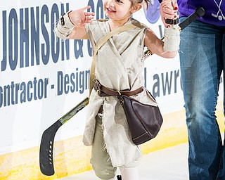 Scott R. Galvin | The Vindicator.Shelby Slanina, 3 of Boardman, waves to the crowd during the Star Wars parade of characters during the first intermission at the Youngstown Phantoms game on Friday, Dec. 29, 2017 at the Covelli Centre.  Shelby was dressed as Rey from the movie series. The Phantoms lost 4-1.