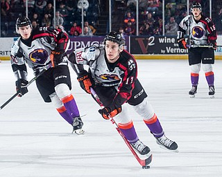 Scott R. Galvin | The Vindicator.Youngstown Phantoms left wing Dalton Hunter (17) skates the puck into the offensive zone against the Madison Capitols during the third period on Friday, Dec. 29, 2017 at the Covelli Centre.  The Phantoms lost 4-1.