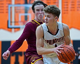 NEW MIDDLETOWN, OHIO - DECEMBER 29, 2017: Springfield's Evan Ohlin looks to pass while being pressured by South Range's Brady White during the second half of their game on Friday night at Springfield High School. DAVID DERMER | THE VINDICATOR
