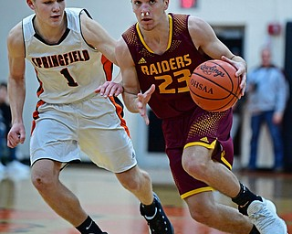 NEW MIDDLETOWN, OHIO - DECEMBER 29, 2017: South Range's Jaxon Anderson looks to pass while driving on Springfield's Evan Ohlin during the second half of their game on Friday night at Springfield High School. DAVID DERMER | THE VINDICATOR