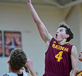 NEW MIDDLETOWN, OHIO - DECEMBER 29, 2017: South Range's Brennan Toy goes to the basket over Springfield's Evan Ohlin during the second half of their game on Friday night at Springfield High School. DAVID DERMER | THE VINDICATOR