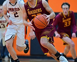 NEW MIDDLETOWN, OHIO - DECEMBER 29, 2017: South Range's Jaxon Anderson dribbles away from Springfield's Drew Clark after a steal during the second half of their game on Friday night at Springfield High School. DAVID DERMER | THE VINDICATOR