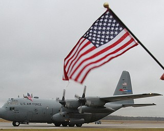 William D. Lewis The Vindicator Well wishers wave flags as  reservists aboard C-130's return from deployment  at YARS  Jan. 18, 2017.
