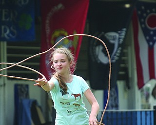 ROBERT K. YOSAY  | THE VINDICATOR..171st Canfield Fair is underway ..  as Eliyana SHank 11 of Berlin Center - with Mahoning Valley Horseman 4-H as she practices for the GROUND ROPING class