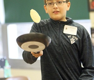 ROBERT K YOSAY  | THE VINDICATOR..Vincent DePizzo of St Rose flips a souffle.....Steady as it goes.. Ursuline High School will hosted 8th Grade Day on Tuesday,  All 8th grade students were invited to learn about Ursuline High SchoolÕs academic, extra-curricular and spiritual offerings...-30-