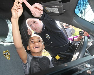 William D. Lewis The Vindicator   YPD Ptlm Steven Gibson in Homestead park where he befriended some local kids and became a star on facebook. He is shown here in his cruiser with  Colde Adams, 8.