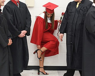 Gianna Gentile adjusts her heels before the Struthers High School Graduation, Sunday, May 28, 2017 in Struthers...(Nikos Frazier | The Vindicator)