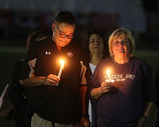 David and Pat Leo stand with candles during a vigil for their son, Girard Police Officer Justin Leo, Sunday, Oct. 22, 2017, at Arrowhead Stadium in Girard. Officer Leo was killed while responding to a potential suicide around 10:00 p.m., Saturday, Oct. 21, 2017, on the 400 block of Indiana Ave in Girard. Officer Leo was transported to St. ElizabethÕs Youngstown for surgery where he later died. ..(Nikos Frazier | The Vindicator)