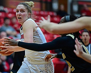 YOUNGSTOWN, OHIO - DECEMBER 30, 2017: Youngstown State's Anne Secrest drives on Oakland's Nikita Telesford during the second half of their game on Saturday afternoon at Beegley Center. Oakland won 58-48. DAVID DERMER | THE VINDICATOR
