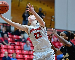 YOUNGSTOWN, OHIO - DECEMBER 30, 2017: Youngstown State's Sarah Cash grabs the pass over Oakland's Mercy Agwaniru during the second half of their game on Saturday afternoon at Beegley Center. Oakland won 58-48. DAVID DERMER | THE VINDICATOR
