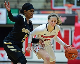 YOUNGSTOWN, OHIO - DECEMBER 30, 2017: Youngstown State's Chelsea Olson drives on Oakland's Kha'Keya Graves during the second half of their game on Saturday afternoon at Beegley Center. Oakland won 58-48. DAVID DERMER | THE VINDICATOR