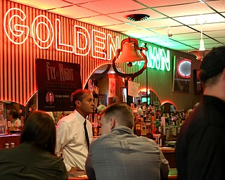 Bartender Patrick Casseday watches customers enjoys the final drinks at Golden Dawn Restaurant, Saturday, April 29, 2017 in Youngstown. Golden Dawn closed after 83 years in the Valley after its future was debated between the two co-owners/brothers after their fathers death last spring...(Nikos Frazier | The Vindicator)..