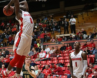 Youngstown State forward Tyree Robinson (0) dunks the ball as Youngstown State guard Braun Hartfield (1) cheers him on during the first half of a NCAA College Basketball game, Tuesday, Nov. 14, 2017, at Beeghly Center in Youngstown. Youngstown State won 134-46...(Nikos Frazier | The Vindicator)..