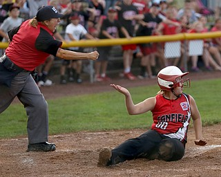 Canfield runner Bridgett Kelly(00) is called out by the home plate umpire after being tagged out by Poland catcher Emily Denney(10) during the 6th inning as Canfield takes on Poland in the 12u Little League district title, Monday, July 3, 2017 at Fields of Dreams in Boardman. Poland won 7-6...(Nikos Frazier | The Vindicator)..