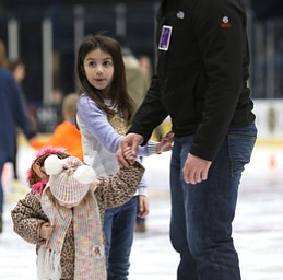 Dustin Rivera of Girard ice skates with his daughters, Camille(3)(left) and Lilah(7)(center) during First Night Youngstown, Sunday, Dec. 31, 2017, at the Covelli Centre in Youngstown. ..(Nikos Frazier | The Vindicator)